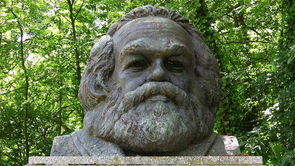 """The headstone of Karl Marx with the epitaph, 'Workers of all lands unite"""""""