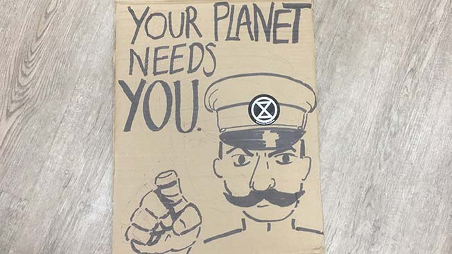 Your Planet needs you protest sign army man pointing at the reader