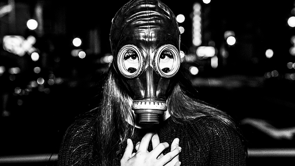 A woman wearing a gas mask. Photograph: micadew via Flickr. Creative commons license: https://creativecommons.org/licenses/by/2.0/e: