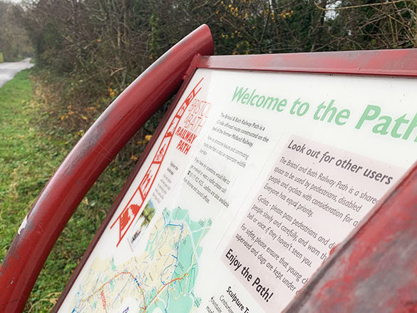 A red sign that says welcome to the path, with information on the path