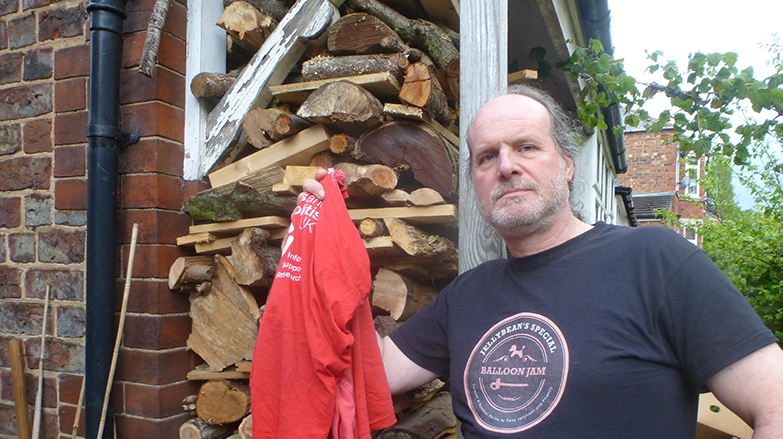 man standing with red t-shirt - laundry item