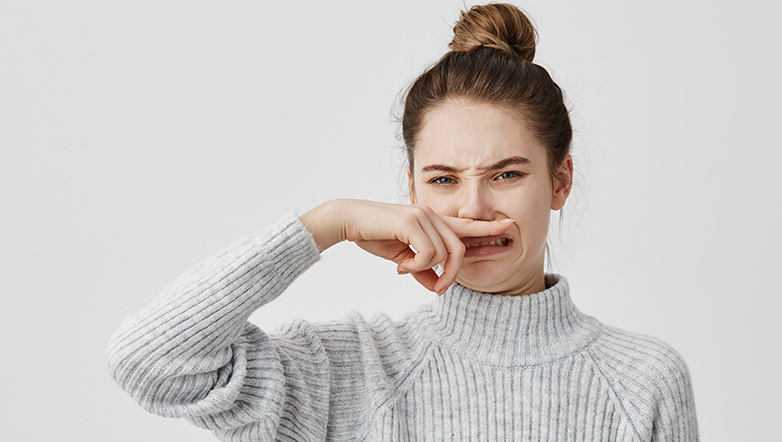 woman with finger on nose